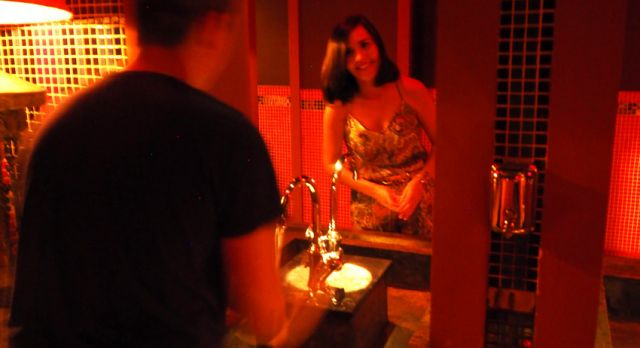 """Surprise at the restroom at """"Lost Heaven"""". The """"mirror"""" is not a mirror, it's an opening between the ladies and the gents!  Photo: Björn Lundström"""