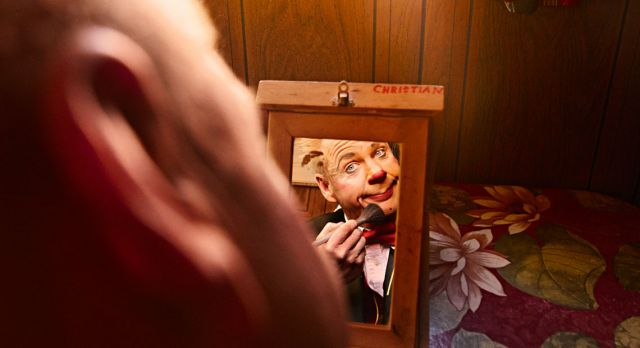 Christian Hofer, 42, becomes Don Christian, the clown, a couple hours before the show. Photo: Mattias Bardå