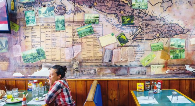 Old map of Cuba on a wall at a diner in Miami´s Little Havana. Photo: Vanessa Rogers