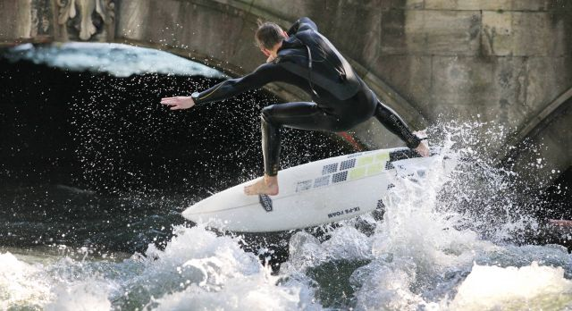 Surfers ride the famous Eisbach Welle in the Englisher Garten all year round.