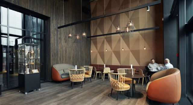 Crowne Plaza lounge with upcycled wooden walls and floor. Photo: Crowne Plaza