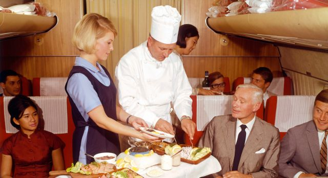 Swedish chef Tore Wretman enjoys First Class service in 1960.
