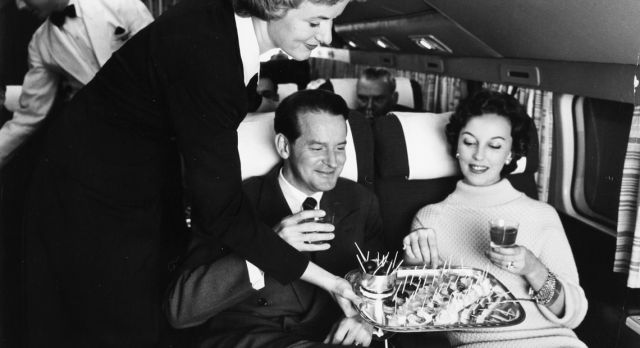 A SAS air hostess serving passengers snacks in the 1950s.