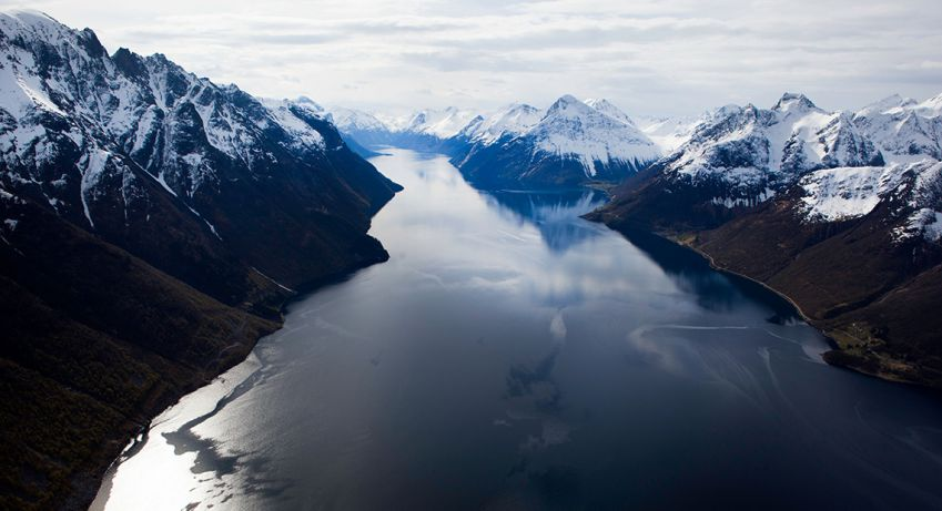 A helicopter tour will show you the Sunnmøre Alps at their most dramatic. Photo: Evy Andersen