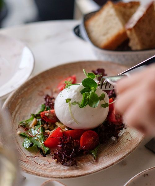 The creamy Burrata cheese is a local favourite that you must not miss when in Bari. Photo: Chiara Magi
