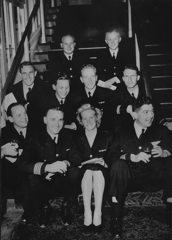 With the first SAS flight to New York behind them, a satisfied crew poses on the stairway at the Waldorf Astoria. Flight attendant Gun Aleman is fl anked by Captains Byron Cramblet and Niels Steen.