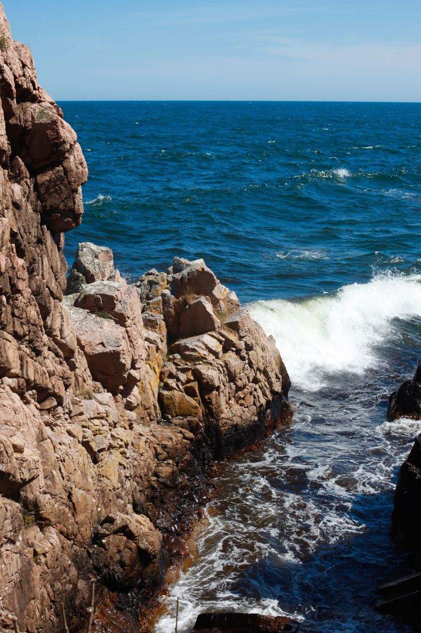 Wild cliffs and surging seas on Bornholm. Photo: Lise Hannibal