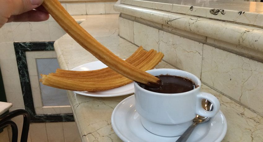 You can not visit Spain without trying Churros con chocolate.