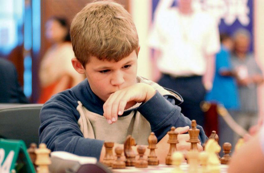 Magnus Carlsen as a child - try playing against him in the app Play Magnus!