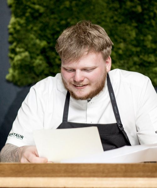 Rasmus Munk studying SAS vintage menus Photo: Maria Kejser Petersen