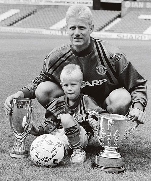 Manchester United goalkeeper Peter Schmeichel with son Kasper at the League Cup and UEFA Super Cup at Old Trafford, Manchester, August 1992. Photo: GETTY