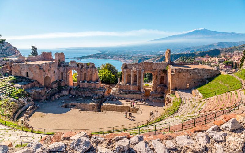 The ancient Greek theater of Taormina, Sicily, with Mount Etna in the background. Photo: Shutterstock