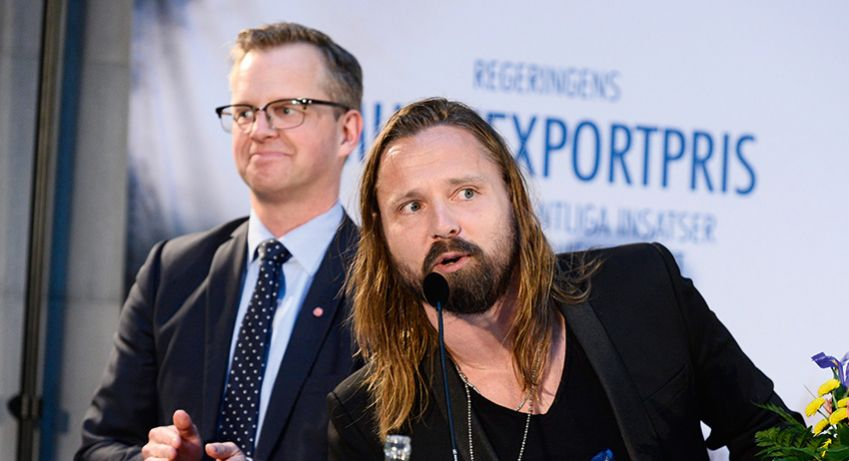 Max Martin, right, receives 2014 Music Export Prize from Sweden's Minister for Industry Mikael Damberg.