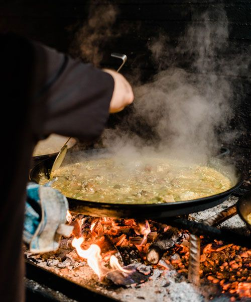 The restaurant Casa Carmela in Valencia cook their paella in large pans over open fire. Photo: Rox & San
